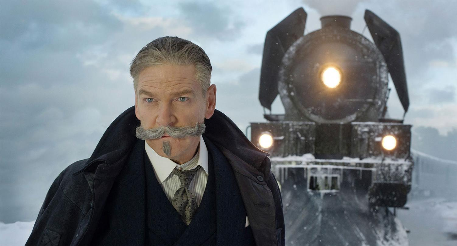 Kenneth Branagh as detective Hercule Poirot in front of the Orient Express