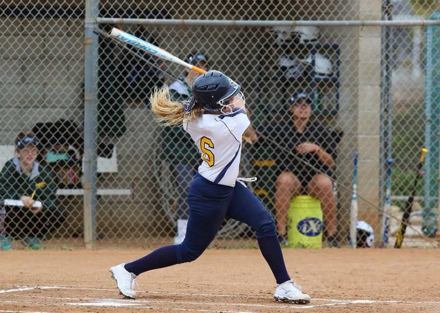 Mesa Olympian taking a swing that ended in them completing a run. Picture credit to SD Mesa Softball Facebook.