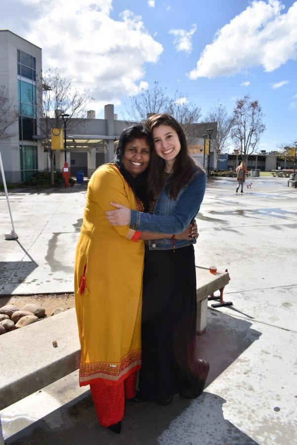 Renuka Zellars (Left) and Jenna Christakis sharing an embrace after Zellars explained her experience with labor trafficking as a young child