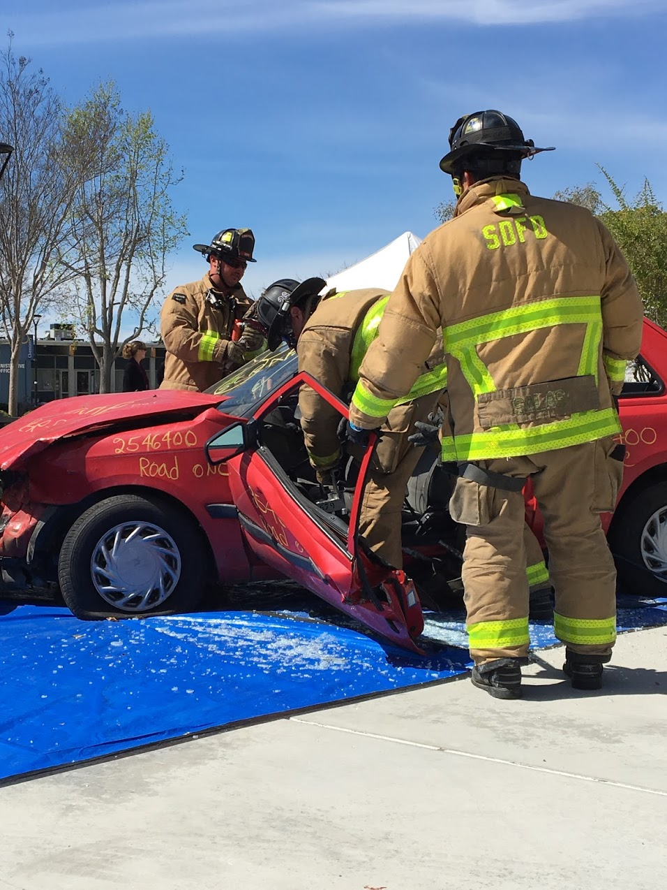 Firefighters from Station 28 in San Diego demonstrated using the Jaws of Life to rescue passengers from a wrecked vehicle