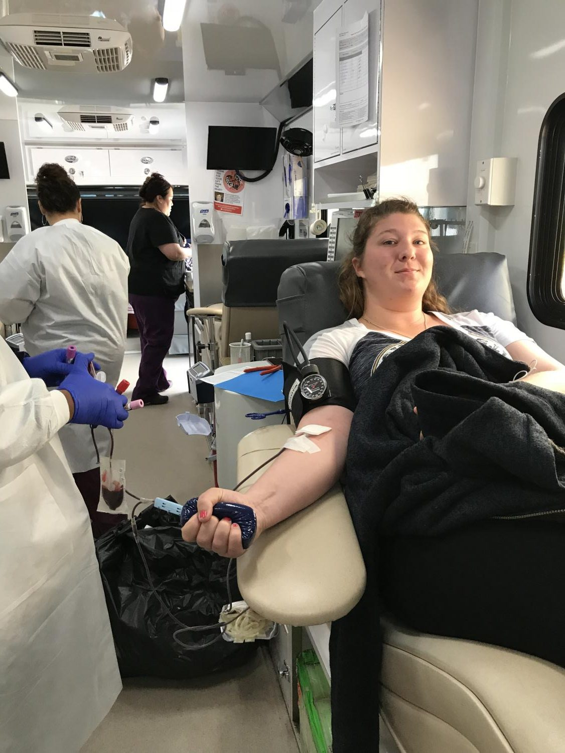 Mesa student Aubrey Oster donates blood to the San Diego blood bank