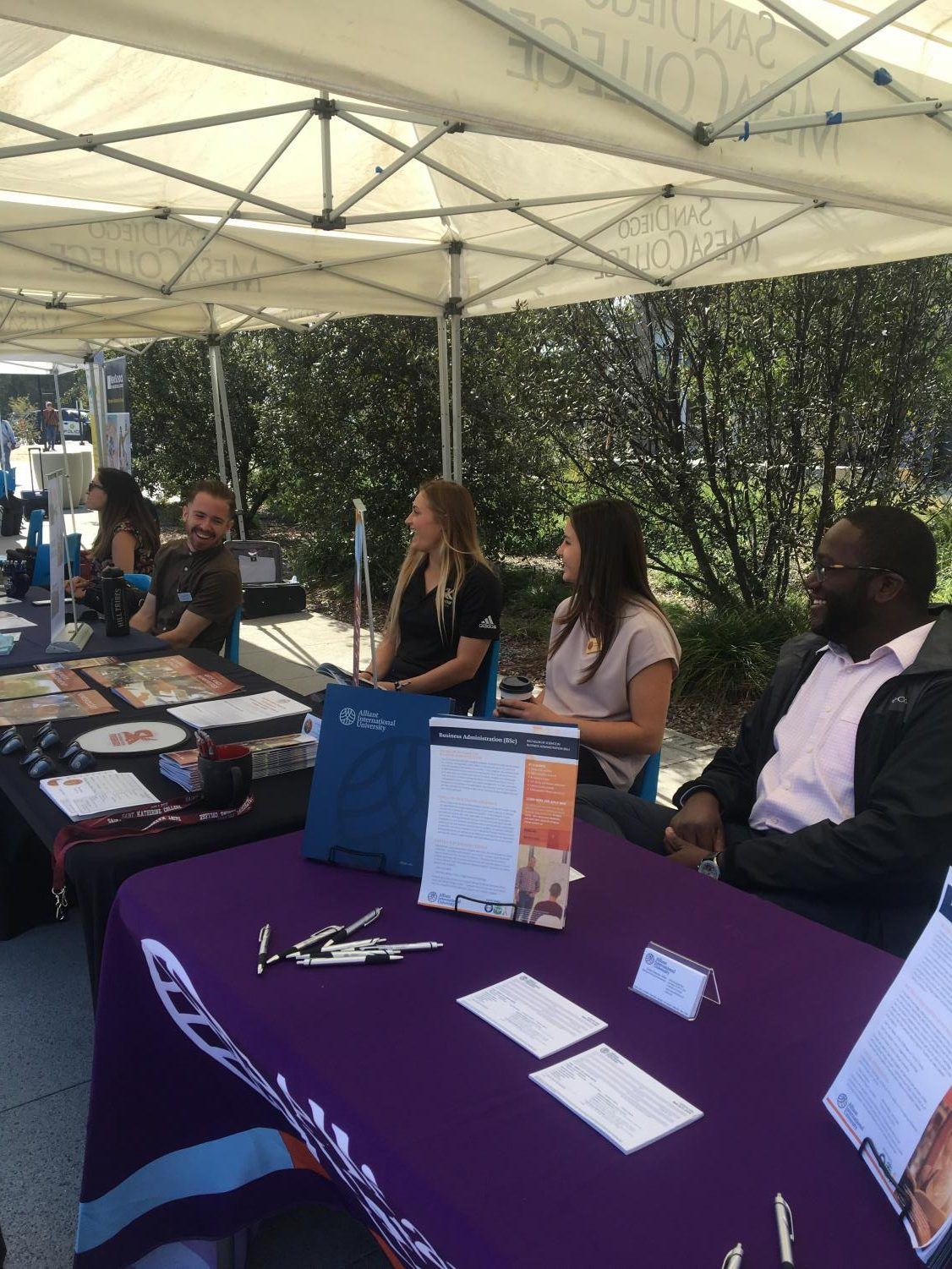 Representatives from San Diego Christian College, University of Saint Katherine, and Alliant International University ready to give students information