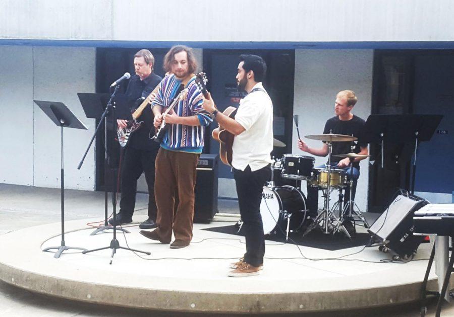 Pictured from left to right: Bill Pfeifer (electric bass), Joshua Jones (drums), Vito  Williams (trumpet), Matias de Hoyos (electric guitar), and David Sullivan (vibraphone).
