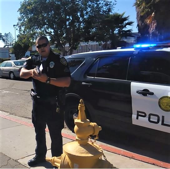 SDCCD Police Officer pulling gun on a photographer.