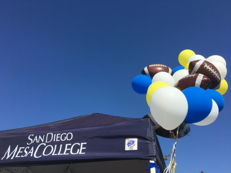 Entrance booth at tailgate event with Mesa College colors and football balloons attached to support Olympians on Sept. 22.