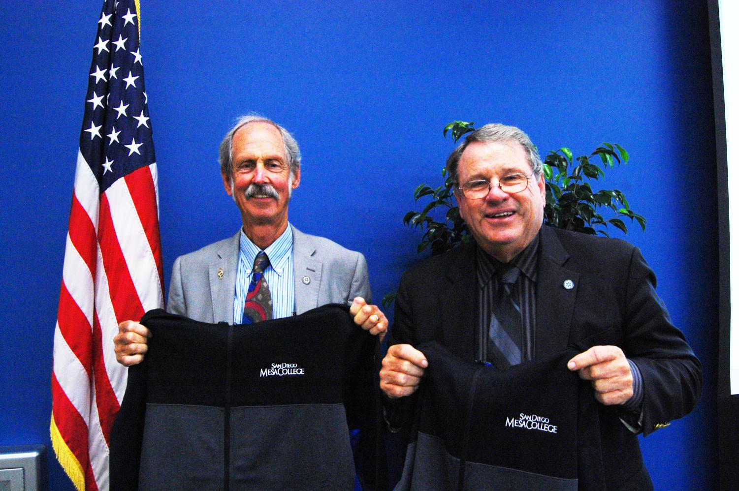 Rich Grosch (right) and Peter Zschiesche (left) were gifted Mesa College hoodies by Mesa faculty at the Nov. 8 Board of Trustees meeting, commemorating the trustees' contributions to the district.