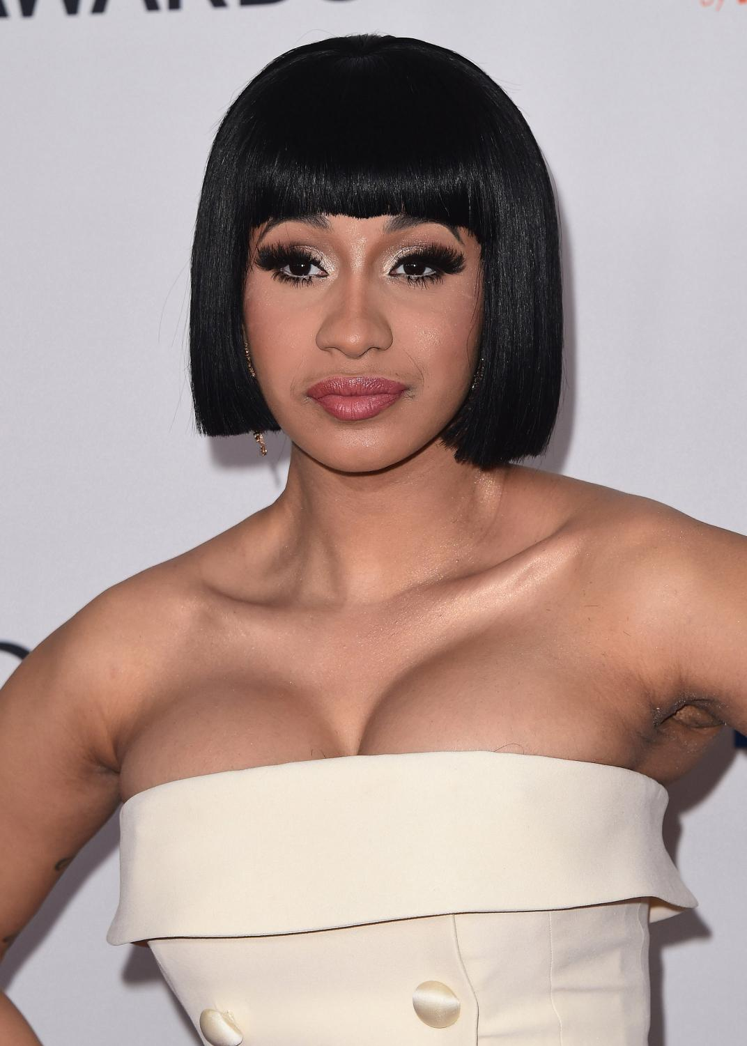 Cardi B posing at the 2018 Clive Davis Pre-Grammy Gala. Photo Credit: MCT Campus