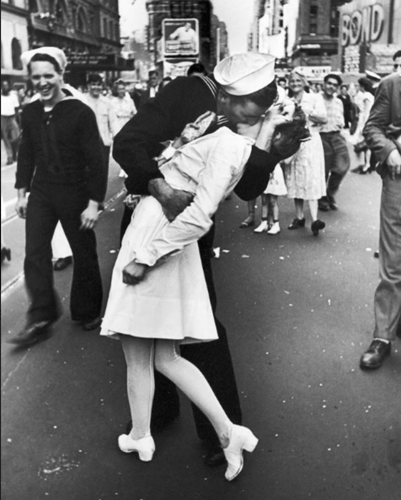 U.S. Navy Sailor kissing a stranger on V-J day in Times Square captured by Alfred Eisenstaedt in 1945.