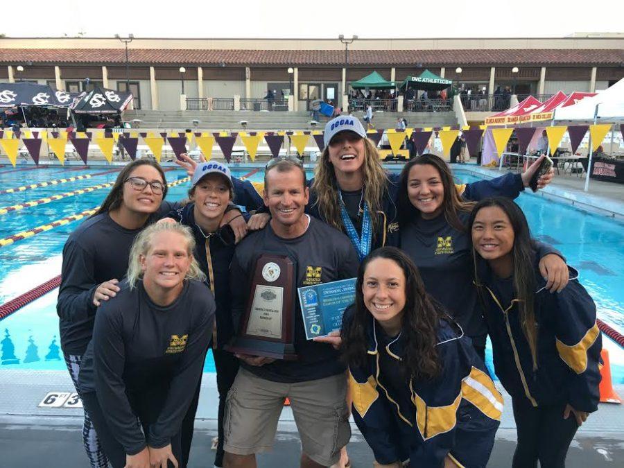 Victorious Mesa Olympians and their coach. Left to right - Thias Luiz, Carly Lupien, Julie Parsons, Coach Jim Fegan, Allyson Hansen, Danielle Zambrana, Mia Lauer and Kiri Flatter.