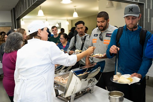 Hungry students gratefully accept Thanksgiving dishes prepared by the Culinary Arts/Management Program. Photo credit: Office of Communications