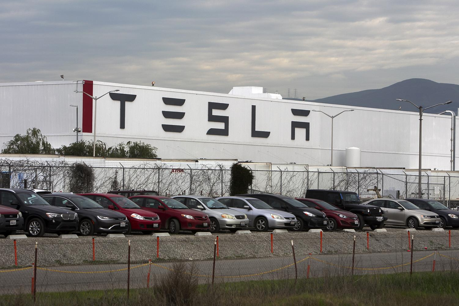 Tesla will only accelerate us 10 feet into the future, and into the next traffic jam. Photo credit: MCT Campus