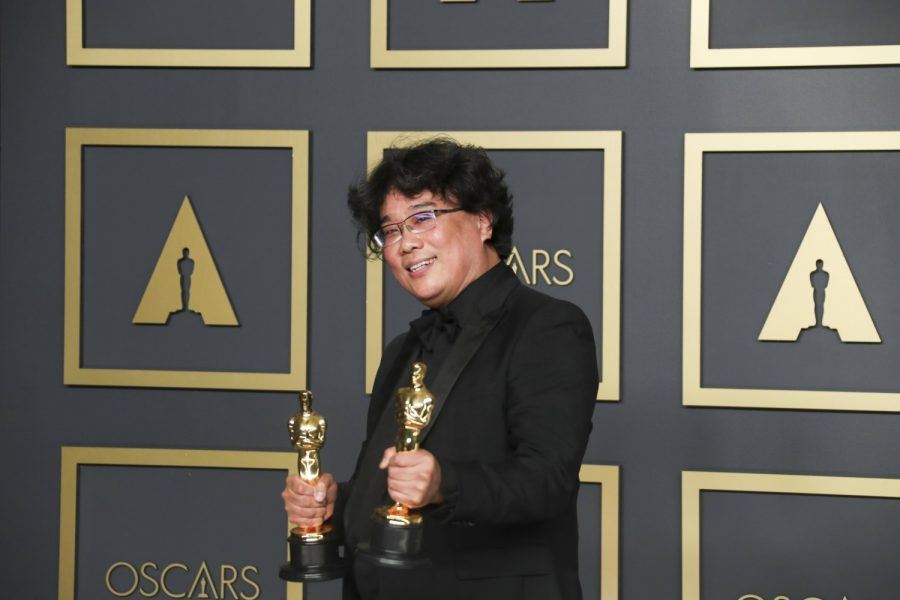 Bong Joon-Ho holding his Oscars for his work on 'Parasite.'
