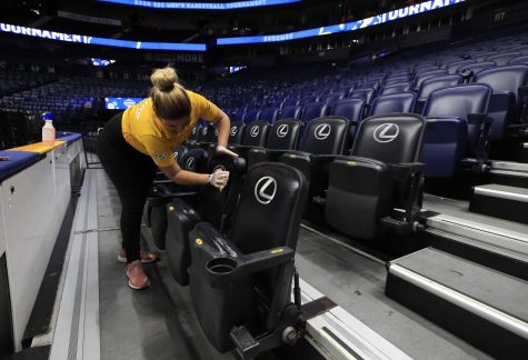 Workers clean the Bridgestone Arena in Nashville, Tenn. after the SEC basketball championship was canceled during play. Photo Credit: MCT Campus