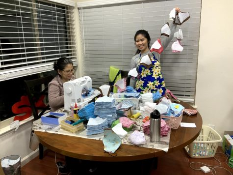 Hoang Nguyen and daughter Khanh Huynh have turned their dining room into a production facility for face masks, topping 2,000 pieces.
