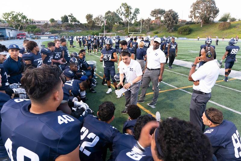The+Mesa+football+team+huddle+together+to+hear+their+coach+speak.