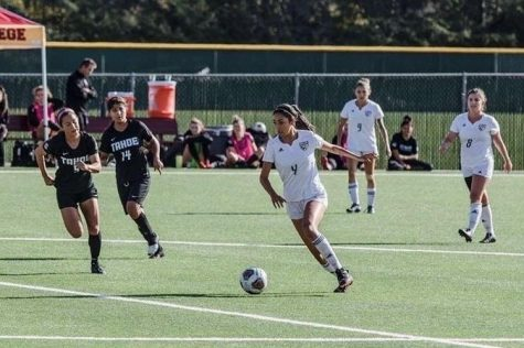 Ravelo dribbing the ball down field ready to make a goal.