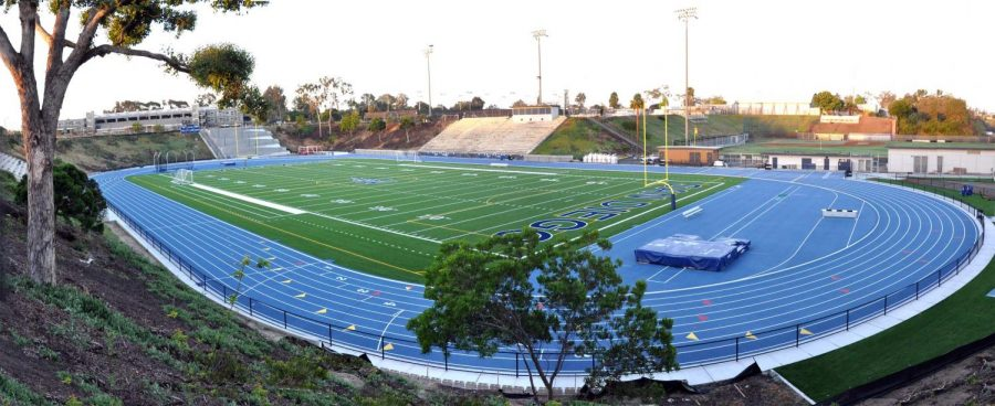 Landscape photo of San Diego Mesa's Stadium. Empty field and empty seats.