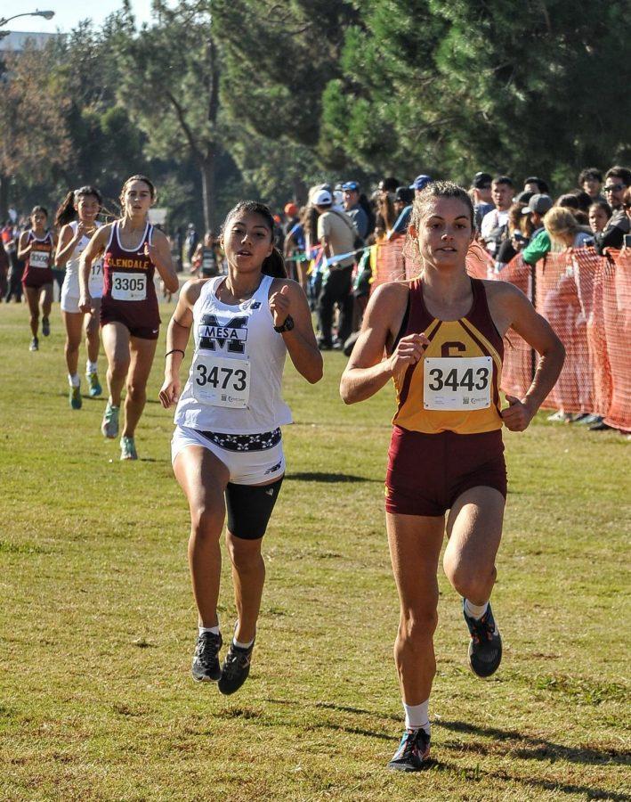 Yahaira Zuniga pushing forward at last years State track meet.