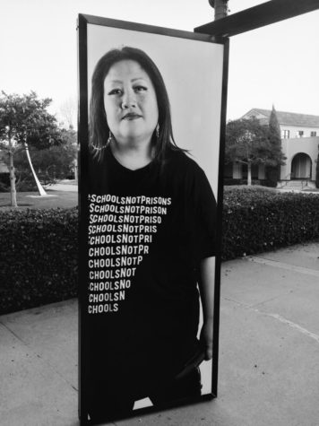 """DJ Kuttin Kandi in collaboration with """"Transcending Perception,"""" an art installation by photographer Josemar Gonzalez and the AjA Project. Hosted in the Arts District at Liberty Station (NTC Foundation)."""