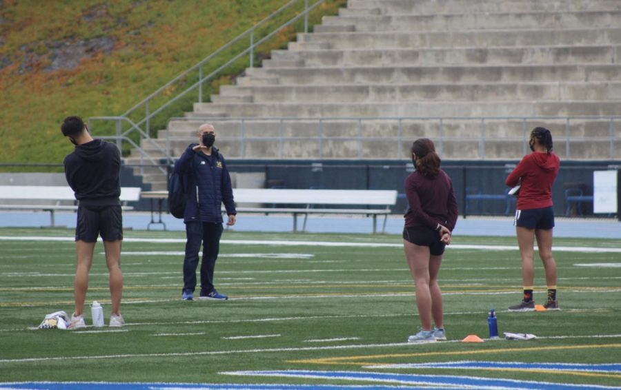 Sean+Ricketts%2C+head+coach+of+track+and+field%2C+welcoming+back+his+athletes+and+prepares+them+for+the+workout.