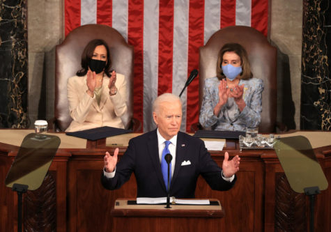 President Joe Biden outlines his administrations policy goals for infrastructure and tax hikes before a joint session of Congress.